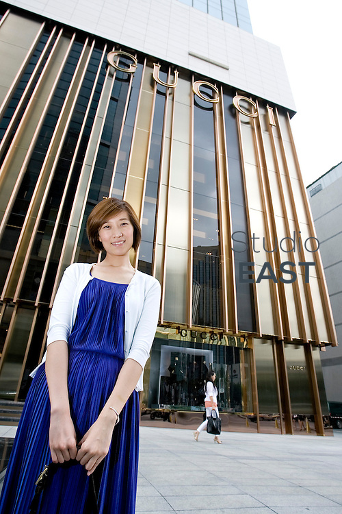 SHANGHAI, CHINA - September 15: Liu Yi in front of Gucci flagship store in Shaanxi Bei lu, near Plaza 66 on September 15, 2009 in Shanghai, China. (Photo by Lucas Schifres/Getty Images)