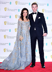 Michelle Yeoh and Will Poulter in the press room at the 72nd British Academy Film Awards held at the Royal Albert Hall, Kensington Gore, Kensington, London.