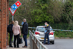 © Licensed to London News Pictures. 01/04/2021. Reading, UK. Police investigators at the scene on Chalfont Way, Lower Earley, Reading following a serious incident of assault outside a BP petrol station which occurred at approximately 7:40pm on Wednesday 31/03/2021, a 51-year-old man was taken to the Royal Berkshire Hospital in a critical condition with life-threatening injuries. Photo credit: Peter Manning/LNP
