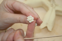 bread decoration in small flower shape on fingers