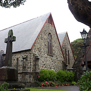St Mary's Church Vivian Street, New Plymouth.The oldest stone church in New Zealand. Designed by Architect Frederick Thatcher, the original church was opened in 1846 and forms part of the present building. Benjamin Mountfort was responsible for the sanctuary, a five-sided apse. (1893). Marsland Hill behind the church was once a pa and then the headquarters of the British Army in north Taranaki during the 1860s. New Plymouth, Taranaki, New Zealand, 22nd December 2010. Photo Tim Clayton
