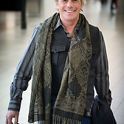 NLD/Amsterdam/20140212 - Aankomst Amerikaanse acteur Christopher Atkins - Bomann op Schiphol <br /> <br /> Arrival of the American actor Christopher Atkins Bomann on Schiphol in Amsterdam Netherlands