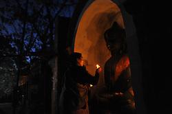 January 2, 2018 - Kathmandu, Nepal - Nepalese Hindu devotee offering ritual prayer during Madhav Narayan Festival or Swasthani Brata Katha festival at Hanumante River, Bhaktapur, Nepal on January 2, 2018. Nepalese Hindu women observe a fast and pray to Goddess Swasthani for Long life of their husbands and family prosperity during a month-long fasting festival celebration. (Credit Image: © Narayan Maharjan/NurPhoto via ZUMA Press)