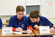 Waiting for the fourth round to begin, the Edmonson County, Ky., High School Quiz Bowl team members are, seated, from left, Brycen Daniels, 13, a seventh-grader, Evy Bolton, 13, a seventh-grader, Brody Johnson, 14, an eighth-grader and team captain and Jonas Miller, 14, an eightth-grader. Standing behind them are the coach Gregory Grey, Robin Grey and substitute player Emma Sackett, 12, a seventh-grader.<br /> <br /> Teams compete in the preliminary rounds of the 2019 Kentucky Quiz Bowl Alliance Middle School State championship Saturday, April 27, 2019, at Noe Middle School in Louisville, Ky. (Photo by Brian Bohannon)