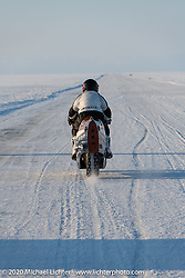 Team mechanic-tuner Simon Pitelet taking a pass on the mile long course on custom bike builder Bertrand Dubet's partially streamlined Aprilia RSV4 racer during the Baikal Mile Ice Speed Festival. Maksimiha, Siberia, Russia. Friday, February 28, 2020. Photography ©2020 Michael Lichter.