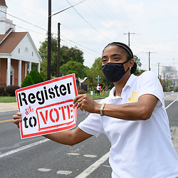 NAACP volunteers including Felecia Williams-Dennis,  help register Travis County, Texas voters in east Austin during a push to engage voters before the early October deadline. Texas, usually a solid Republican stronghold, might prove to be a battleground on November 3rd.