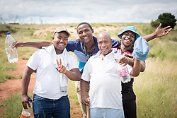 3 March 2017, Thaba Bosiu, Lesotho: Left to right: Kamohelo Tiheli, Retselisitsoe Sekoati, Scott Ramoriting, and Khotso Moleli. Staff from the Blue Cross Rehabilitation Centre for patients suffering from alcohol or drug abuse, visit the mountain of Thaba Bosiu ('Night Mountain'), in Lesotho. The rehabilitation centre is the only one of its kind in the country. Thaba Bosiu is a sandstone plateau some 24 kilometers east of Lesotho's capital, Maseru. The name means Night Mountain, and surrounding the plateau is a small village and open plains. Thaba Bosiu was once the capital of Lesotho, and the mountain was the stronghold of the Basotho king when the kingdom of Lesotho was formed.