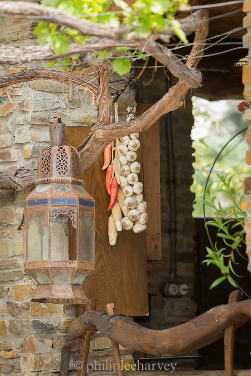 House with open door and old lamp in foreground, Pampaneira, Andalusia, Spain