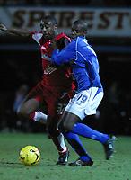 Photo: Dave Linney.<br />Chesterfield v Swindon Town. Coca Cola League 1.<br />28/12/2005.Aaron Brown (Swinden) keeps an eye on the ball against    Reuben Hazell(Chesterfield)