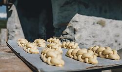 THEMENBILD - am Karfreitag bäckt die Bäckerei Gugglberger zum ersten Mal im Jahr Bauernbrot und Milchbrot bzw. Osterstriezel, im alten, traditionellen Holzofen neben dem Meixnerhaus am Kirchbichl oberhalb von Kaprun, aufgenommen am 10. April 2020 in Kaprun, Oesterreich // on Good Friday the bakery Gugglberger bakes farmhouse bread and milk bread or Osterstriezel for the first time in the year, in the old, traditional wood oven next to the Meixnerhaus at the Kirchbichl above Kaprun in Kaprun, Austria on 2020/04/10. EXPA Pictures © 2020, PhotoCredit: EXPA/Stefanie Oberhauser
