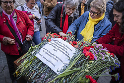 March 28, 2019 - Barcelona, Catalonia, Spain - Women are seen arranging the flowers on the memory plate during the protest..Some 50 people have concentrated to reject the attack on the plaque placed in memory of those tortured by the Francoist repression placed last Monday in front of the old police station of the Spanish police during the Franco regime. (Credit Image: © Paco Freire/SOPA Images via ZUMA Wire)