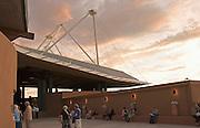 Opera fans in patio of Santa Fe Opera at sunset