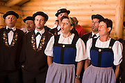 29 JULY 2007 -- BRUNIG, OBWALDNER, SWITZERLAND: Swiss yodelers perform at the Brunig Schwinget, a wrestling tournament in Brunig, in the canton of Obwaldner, Switzerland. Schwingets are Swiss style wrestling tournaments held throughout Switzerland. They are usually held outdoors in Alpine mountain passes. Wrestlers wear special canvas pants over their regular clothes. They grip each others pants and wrestle on bed of sawdust. The Schwinget in Brunig is one of the most popular in Switzerland with over 6,000 spectators and more than 120 wrestlers. There is Swiss Alpenhorn blowing, flag throwing and yodeling at the Schwinget.  Photo by Jack Kurtz