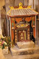 small streetside temple in macau