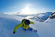 Gus Booth snowboarding above Valdez Alaska