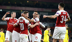 Arsenal's Shkodran Mustafi (centre) celebrates his side's second goal of the game with teammates