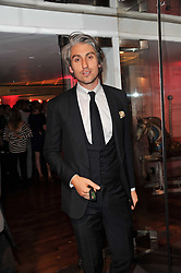 GEORGE LAMB at a party to celebrate the launch of the Lucy in Disguise Ready to Wear collection exclusive to Harvey Nichols, held at The Fifth Floor Restaurant, Harvey Nichols, Knightsbridge, London on 25th May 2011.