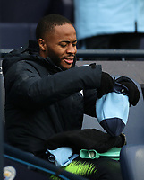 Football - 2018 / 2019 Premier League - Manchester City vs. Everton<br /> <br /> Raheem Sterling of Manchester City with his hot water bottle and hat at The Etihad.<br /> <br /> COLORSPORT/LYNNE CAMERON