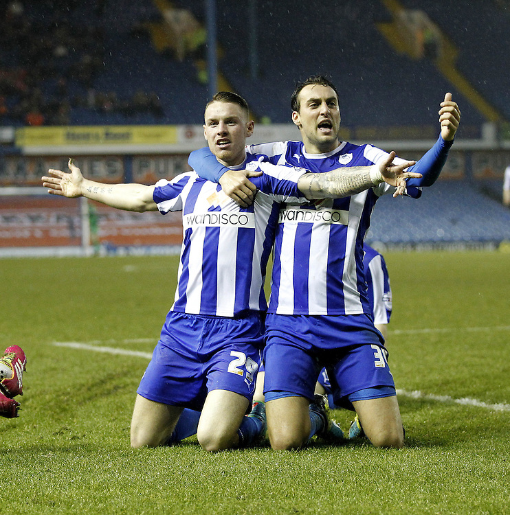 Sheffield Wednesday's Connor Wickham celebrates scoring his sides first goal  with  Atdhe Nuhiu<br /><br />Photo by Mick Walker/CameraSport<br /><br />Football - The Football League Sky Bet Championship - Sheffield Wednesday v Blackpool - Wednesday 1st january 2014 - Hillsborough - Sheffield<br /><br />© CameraSport - 43 Linden Ave. Countesthorpe. Leicester. England. LE8 5PG - Tel: +44 (0) 116 277 4147 - admin@camerasport.com - www.camerasport.com