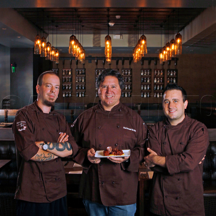 Co-Chef Phillip Bryant, left, Chef Norman Van Aken, at center, and his son Co-Chef Justin Van Aken, at of Norman's 180, a new restaurant developed by world renowned Chef Norman Van Aken, located in Coral Gables. Here they stand in the dining room on September 9, 2010.