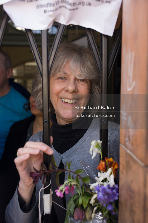 An occupier of Carnegie Library in Herne Hill, south London while approx 20 others remain inside the premises on day 7 of its occupation, 6th April 2016. The angry local community in the south London borough have occupied their important resource for learning and social hub for the weekend. After a long campaign by locals, Lambeth have gone ahead and closed the library's doors for the last time because they say, cuts to their budget mean millions must be saved.