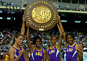 The LSU women's shuttle hurdle relays team of Lolo Jones, RaNysha LeBlanc, Tiffany Robinson and Brittany Littlejohn on the awards podium in the 110th Penn Relays at  Franklin Field on Friday, April 23, 2004 in Philadelphia.