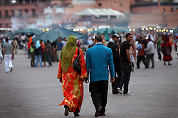 Couples relax while walking through Djemaa el Fna square, meaning Place of the Dead, in Marrakech, Morocco on May 12, 2009.