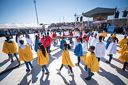 """14 May 2017, Windhoek, Namibia: Thousands of Lutherans and guests gathered for a festival of worship, witness and song and word and sacrament in Sam Nujoma Stadium on Sunday, May 14th to mark commemoration of the 500th Anniversary of the Lutheran Reformation in Windhoek, Namibia. At the beginning of the worship, confirmation students from Namibian churches formed the Luther Rose, through a tailor-made choreography, wearing capes in various colours. Marking the Reformation as global citizen, the worship event drew music, stories, and leadership from the churches of every continent. The service formed a high point of the Twelfth Assembly of the Lutheran World Federation, in Windhoek, Namibia, on 10-16 May 2017, under the theme """"Liberated by God's Grace"""", bringing together some 800 delegates and participants from 145 member churches in 98 countries."""