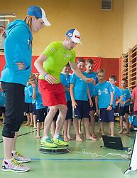 06.05.2013, Volksschule, Dorf an der Pram, AUT, OeSV, Sommer Einkleidung, im Bild Marlies Schild (Ski Alpin OeSV) und Dominik Landertinger (Biathlon OeSV) zeiben den Schuelern eine Uebung vor // during Summer outfitting of Austrian Ski Federation at the elementary school, Dorf an der Pram, Austria on 2013/05/06. EXPA Pictures © 2013, PhotoCredit: EXPA/ Juergen Feichter