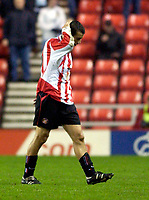 Photo. Jed Wee.<br /> Sunderland v Wigan Athletic, Nationwide League Division One, Stadium of Light, Sunderland. 02/12/03.<br /> Sunderland's Julio Arca hangs his head in shame after being shown a second yellow card.