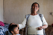 Ljutvia Demyrova - a 29 years old mother of 8 children in her home at the local Roma community in the city of Vinica in Macedonia.