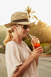 Portrait chic mature blond woman holiday cocktail