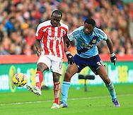 Stoke's Victor Moses battles West Ham's Alex Song - Stoke City vs. West Ham United - Barclay's Premier League - Britannia Stadium - Stoke - 01/11/2014 Pic Philip Oldham/Sportimage
