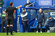 Queens Park Rangers assistant manager John Eustace and Queens Park Rangers manager Mark Warburton during the EFL Sky Bet Championship match between Queens Park Rangers and Derby County at the Kiyan Prince Foundation Stadium, London, England on 23 January 2021.