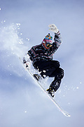 Snowboarder flying throught the air.