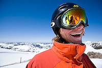 Young man smiling at camera while snowboarding at Kirkwood resort near Lake Tahoe, CA.<br />