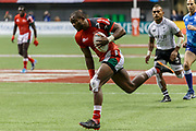 VANCOUVER, BC - MARCH 11: Willy Ambaka (#12) of Kenya scores the 1st try during Game # 45- Cup Final Fiji vs Kenya Cup Final match at the Canada Sevens held March 11, 2018 in BC Place Stadium in Vancouver, BC. Final score: Fiji- 31, Kenya- 12. (Photo by Allan Hamilton/Icon Sportswire)