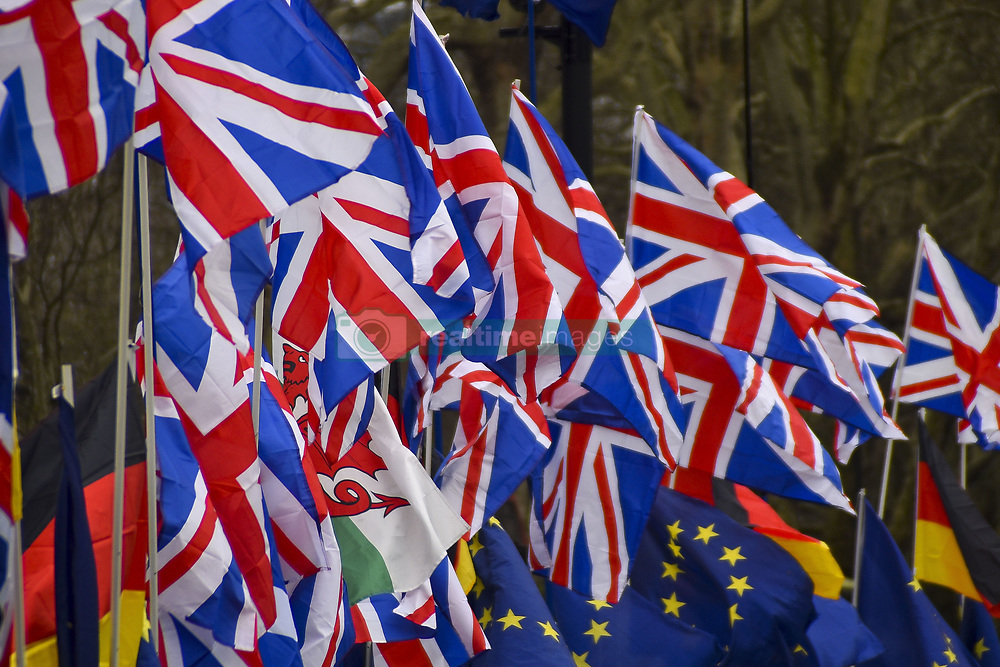 March 28, 2019 - London, United Kingdom - Pro Brexit supporters have put 34 Union Flags outsidethe Houses of Parliament, London on March 28, 2019. The Commons failed to find a majority for a way forward after voting for eight different options on Wednesday. Prime Minister Theresa May has announced that she will quit once Brexit will be delivered, if her withdrawal agreement is approved. (Credit Image: © Alberto Pezzali/NurPhoto via ZUMA Press)