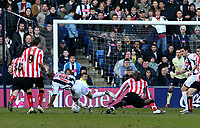Photo: Mark Stephenson.<br />West Bromwich Albion v Sunderland. Coca Cola Championship. 03/03/2007.<br />West Brom's Diomansy Kamara is brought down by Nyron Nowworthy but nothing is given by the Referee