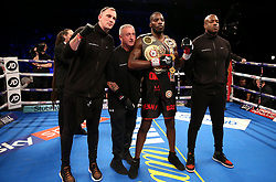 Lawrence Okolie (centre right) with his training team after the WBA continental cruiserweight championship at The O2 Arena, London.