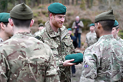 The Duke of Sussex carries out a Green Beret presentation during a visit to 42 Commando Royal Marines at their base in Bickleigh.