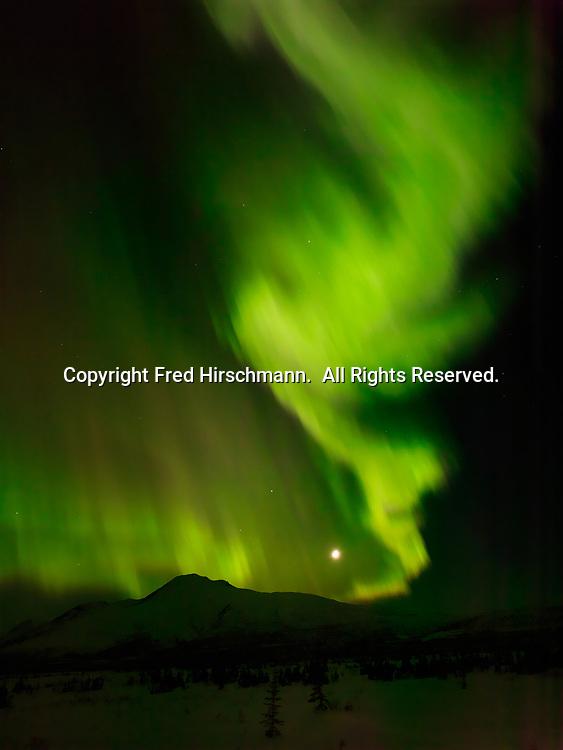 Green aurora borealis with moon above Sheep Mountain, night of March 16-17, 2013, Tahneta Pass, Alaska.