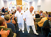 Naples residents Bob Prussack, left, and Neil Herrick walk down the aisle together as a married couple greeting their wedding guests at Temple Shalom on Sunday, May 31, 2015, in North Naples. After 43 years together as a couple, Herrick and Prussack became the first same-sex couple to be married at Temple Shalom.