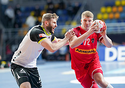 14.01.2021, 6th of October Sports Hall, Gizeh, EGY, IHF WM 2021, Österreich vs Schweiz, Herren, Gruppe E, im Bild Samuel Roethlisberger, Lukas Hutecek, // during the IHF men's World Championship group E match between Austria and Switzerland at the 6th of October Sports Hall in Gizeh, Egypt on 2021/01/14. EXPA Pictures © 2020, PhotoCredit: EXPA/ Diener/Eva Manhart<br /> <br /> *****ATTENTION - OUT of AUT and SUI*****