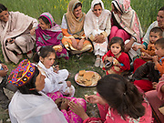 Family of the bride gathers to gossip at a village wedding, Chapursan valley.