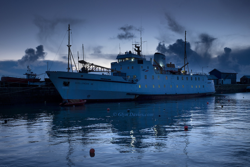 As dawn gave way to very early morning, the white sided Isles of Scilly steamship, the Scillonian III became visible against Penzance quayside last week. Interior cabin lights burned yellow against the cool blues of the morning light and there was silence as the world woke up