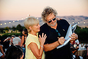 Seattle chef, Tom Douglas, signing his cookbook at the Northstar Winery Harvest Dinner