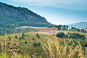 The ancient ruins of the stone Doric Temple of Segesta in the landscape, Sicily, Italy