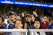 Milpitas fans celebrate a touchdown against Valley Christian High School during Friday Night Lights at Levi's Stadium in Santa Clara, California, on September 18, 2015.  Milpitas went on to lose 22-21 against Valley Christian.  (Stan Olszewski/SOSKIphoto)