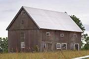 Traditional style Swedish wooden painted house. Barn Fading peeling painting. Smaland region. Sweden, Europe.